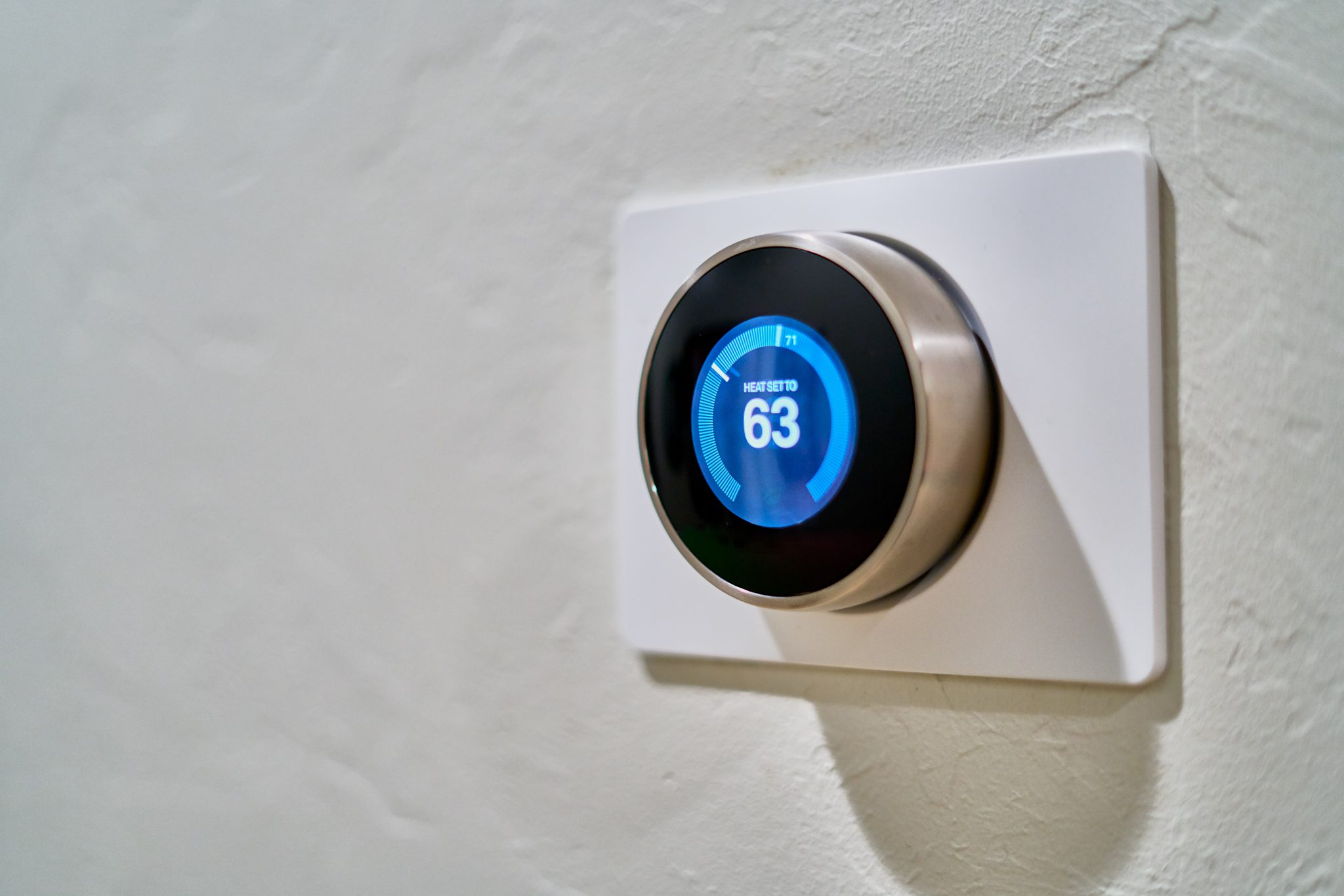 Nest thermostat on a grey wall